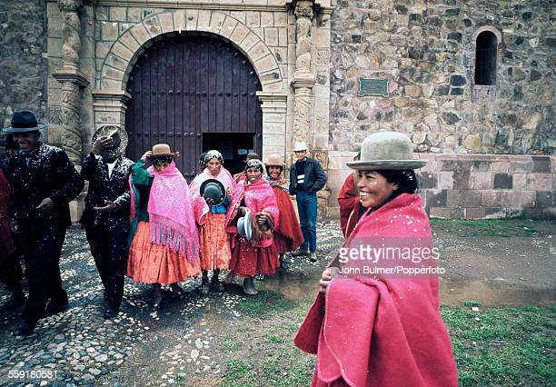 Local guests covered with confetti outside the church during an Aymara wedding in Laja near La Paz in Bolivia 1965