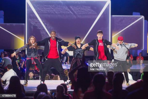 Local hip hop dance group The Connection performs on stage during We Day at Key Arena on March 21 2014 in Seattle Washington