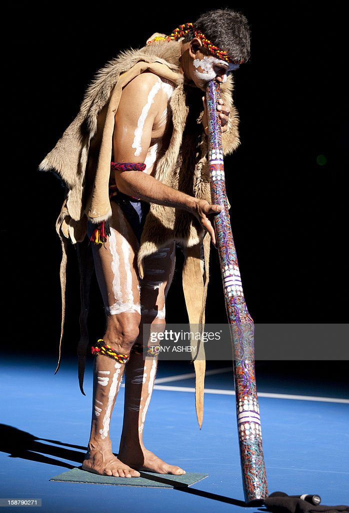 Local indigenous digderidoo player Richard Whalley performs at the opening ceremony on day one of the Hopman Cup tennis tournament in Perth on December 29, 2012. AFP PHOTO / Tony ASHBY USE