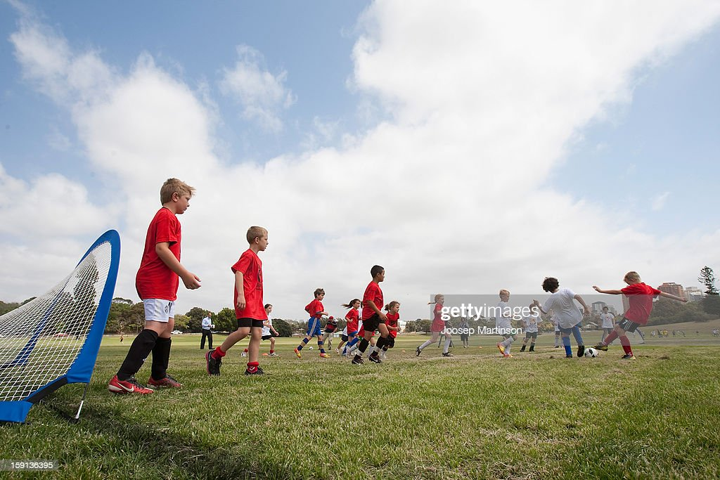 Local junior footballers play during a press conference at Queen's Park on January 9, 2013 in Sydney, Australia. Today marks two years until the 2015 Asian Cup held in Australia.