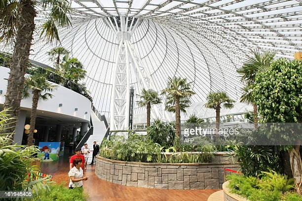 Local Kazakh residents walk inside the new Khan Shatyr tent in Astana on July 14 2010 British architects Foster and Partners have designed Astana's...