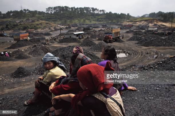 Local Khasi women take a break on a small hill top March 27 2008 at a roadside coal depot on National Highway near the village of Kongong in...