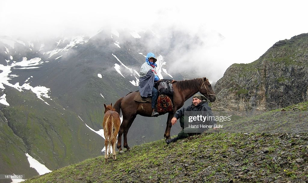 CONTENT] Local Khevsur Omari and German kid Johannes on horseback in the Caucasus mountains of Khevsureti in Georgia Sakartvelo