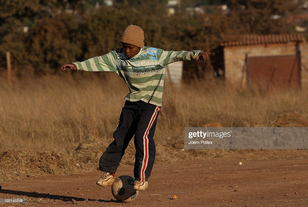 Local kid plays football in a township on June 16, 2010 in Pretoria, South Africa.