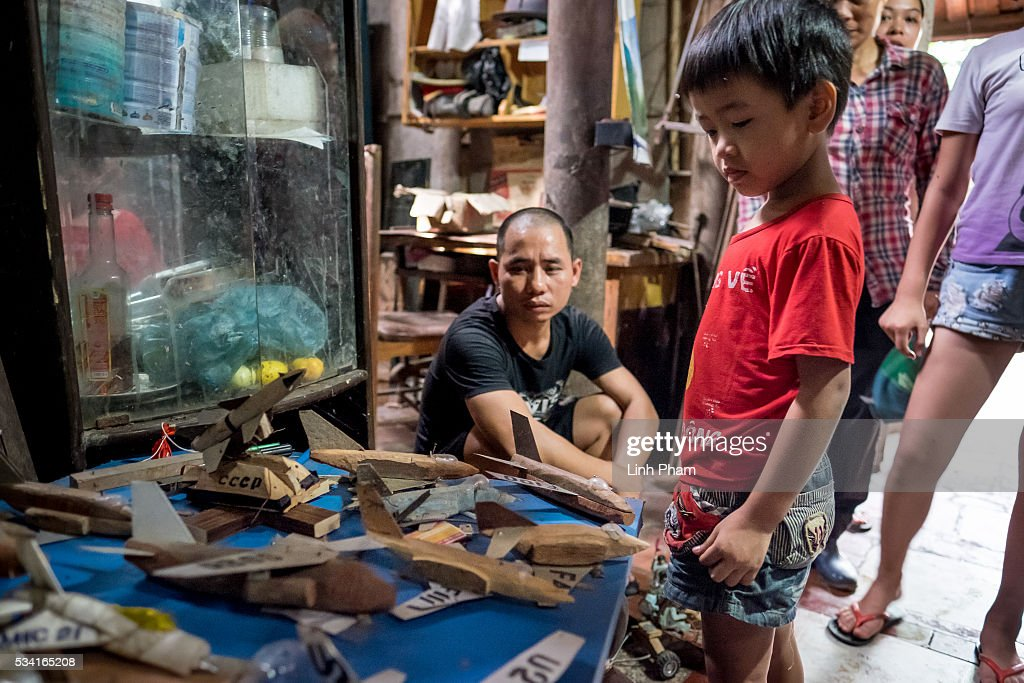Local kid watches the model aircraft exhibition of Ngo Sy Loi, 69 years-old Vietnam War veteran who is passionate about making model war aircraft and vehicles, at Ngo Sy Loi's house on May 25, 2016 in Bac Ninh, near Hanoi, Vietnam. U.S. President Obama made his historic visit to Vietnam on May 23 with an aim to strengthen the strategic and economic relationship between both countries four decades after the Vietnam war. During the visit, Obama announced the U.S. will fully lift its embargo on weapons and raised issues related to human rights while speaking to the youths on freedom of expression.