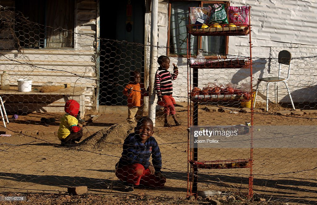 Local kids play football in a township on June 16, 2010 in Pretoria, South Africa.