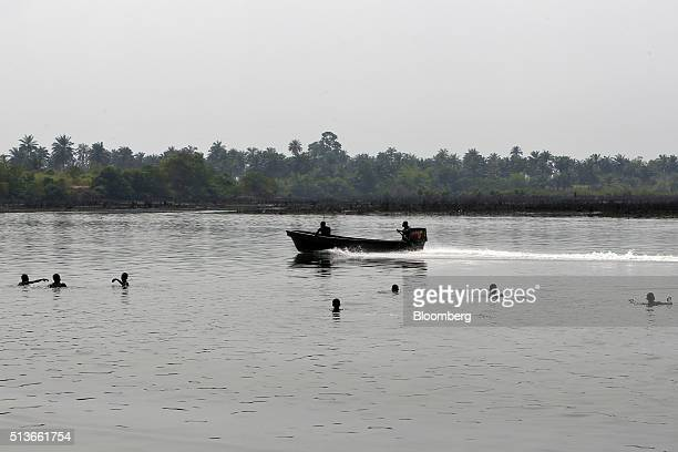 Local kids play in the river polluted by a 2008 oil spill in Bodo Nigeria Wednesday Jan 13 2016 Twenty years after the oilpollution crisis in the...
