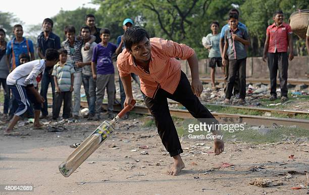 Local kids play street cricket alongside the railway tracks on March 26 2014 in Chittagong Bangladesh