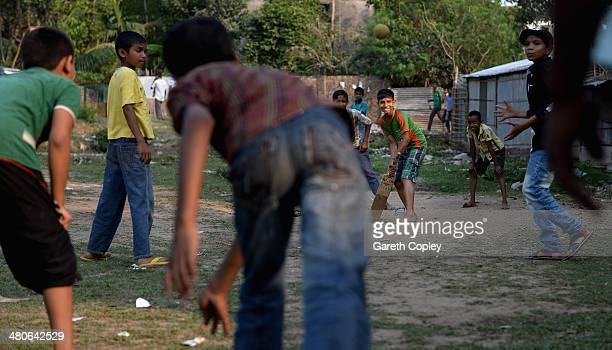 Local kids play street cricket on March 26 2014 in Chittagong Bangladesh