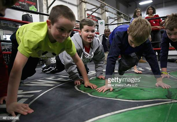 Local kids practice boxing during a community event at Peter Welch's Gym on January 9 2015 in Boston Massachusetts