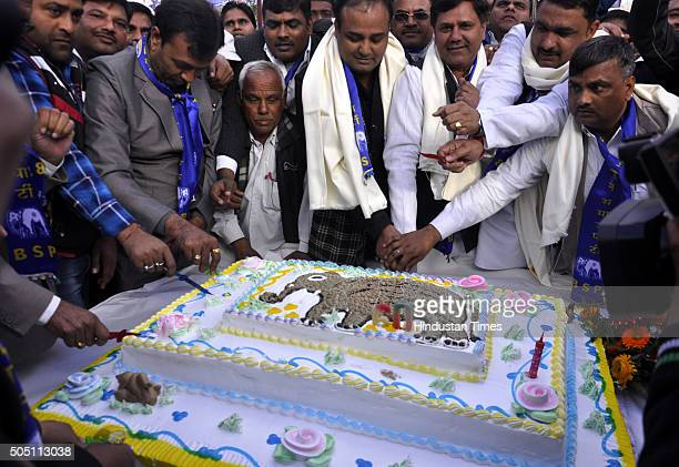 BSP local leaders and workers cut cake to celebrate the 60th birthday of their leader Mayawati at Ambedkar Park on January 15 2016 in Ghaziabad India