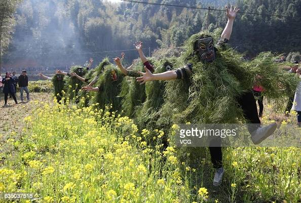 Local male adolescents wearing masks and miscanthus perform Lusheng dance to pray for good yield next year in Miao Autonomous County of Rongshui on...