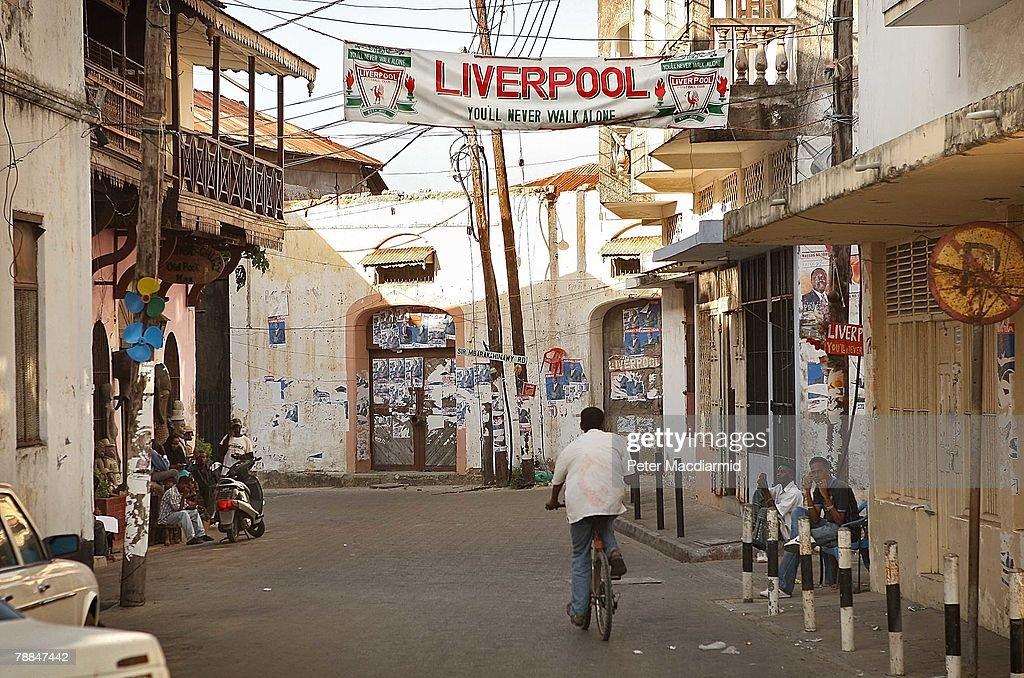 A local man cycles through Old Mombasa on January 9, 2008 in Kenya. Tourism is a $1 billion industry in Kenya. Some tour operators have temporarily banned package holidays over fear of post election violence.