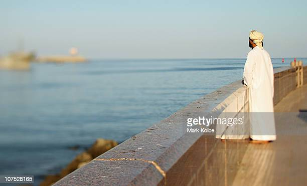 A local man looks out over Muscat harbour at Muttrah corniche on December 9 2010 in Muscat Oman