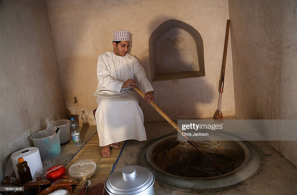 A local man makes a traditional Omani delicacy at Nizwa Fort on the eighth day of a tour of the Middle East on March 18 2013 in Nizwa Oman The Royal...