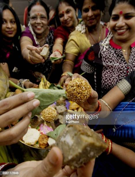 Local married women look along with the recipes of the quotRajo Festivalquot as they are celebration the quotRajo Festivalquot in the eastern Indian...
