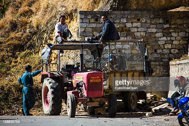 Local men and worker on a tractor on November 18 2012 in Bumthang Bhutan