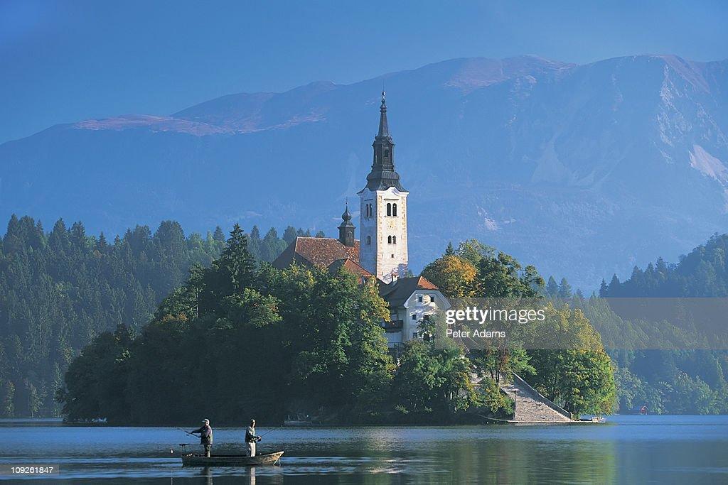 Local men fishing on Lake Bled, Slovenia : Stock Photo