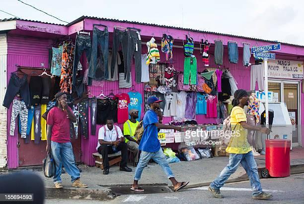 Local men in front of a fashion shop on October 21 2012 in Scarborough Trinidad And Tobago
