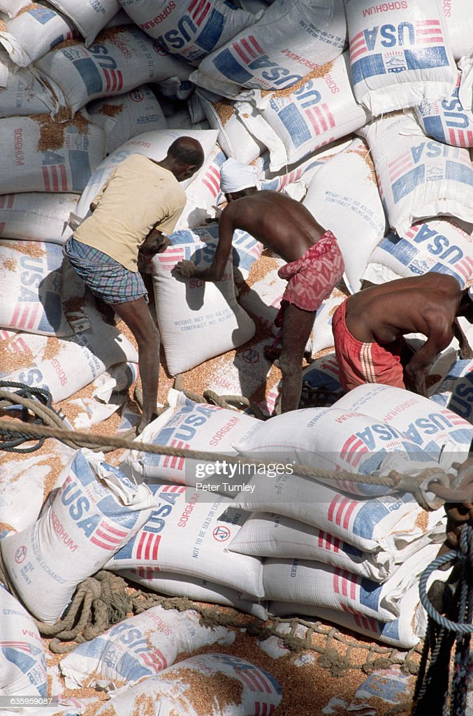 Local men move sacks of food sent as US aid packages during 'Operation Restore Hope' In the 1980s a civil war erupted in Somalia when warlord...