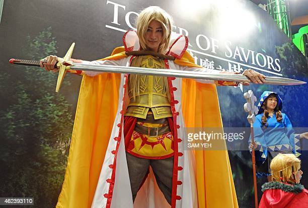 Local models dressed in game costumes for the cosplay pose during the 2015 Taipei Game Show at the World Trade Center on January 28 2015 Over 1400...