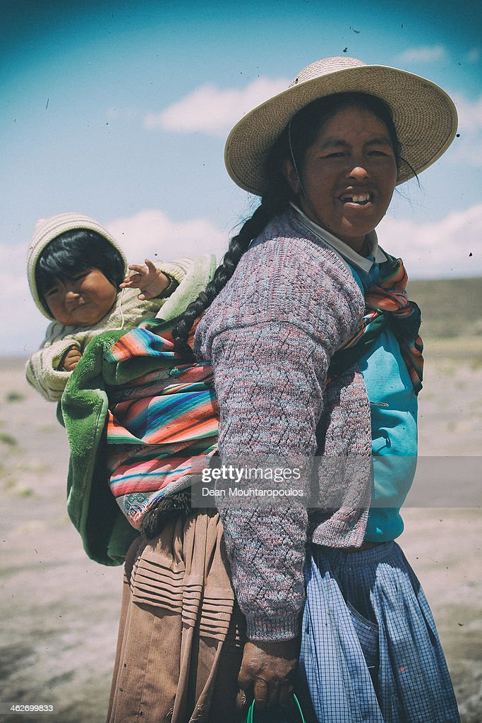 A local mother and child are pictured during Day 9 of the 2014 Dakar Rally near the Salar de Uyuni or Uyuni Salt Flats on January 13, 2014 in Uyuni, Bolivia.