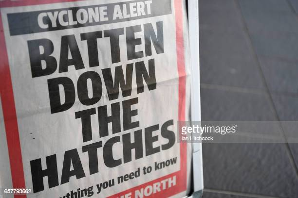 A local newspaper advertisement is seen on display outside a newsagent shop as Townsville residents prepare for Cyclone Debbie on March 26 2017 in...