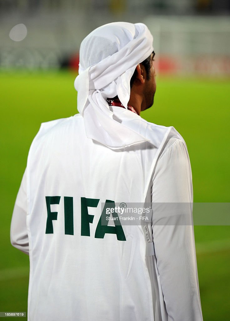 A local offical at the FIFA U 17 World Cup group F match between Sweden and Mexico at Khalifa Bin Zayed Stadium on October 25, 2013 in Al Ain, United Arab Emirates.