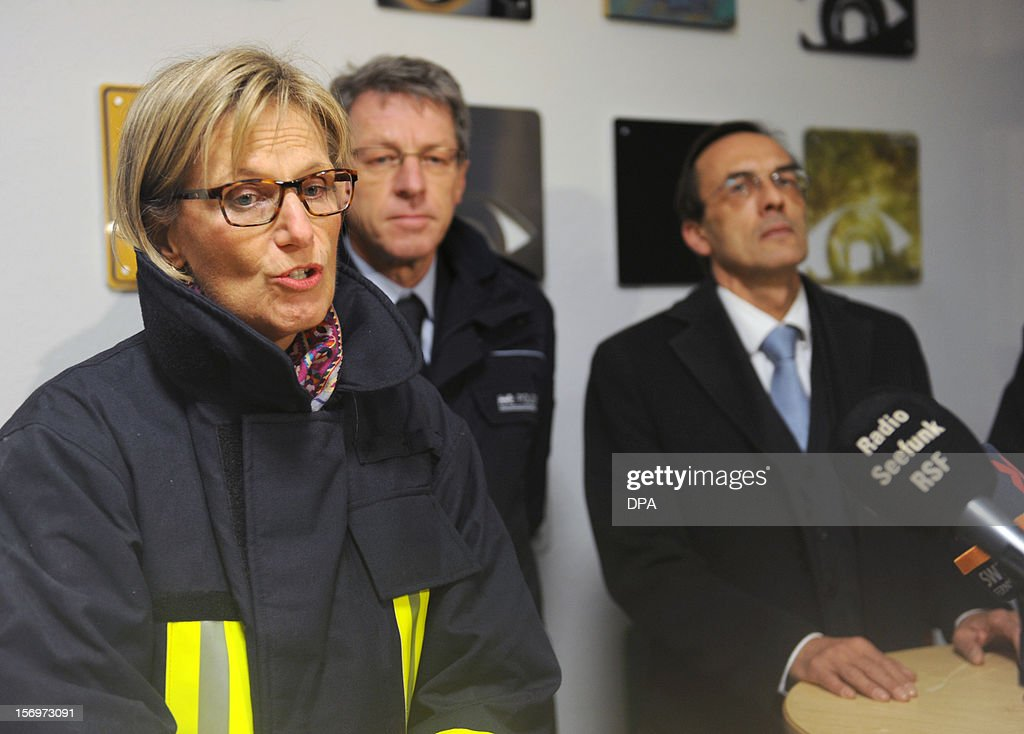 Local official Dorothea Stoerr-Ritter, Chief of Police, Alfred Oschwald Leiter Polizeidirektion Freiburg, and public prosecutor Alfred Haeberle address a press conference after a fire at a workshop for handicapped people in Titisee- Neustadt, southern Germany on November 26, 2012. Fourteen people died after a fire broke out.