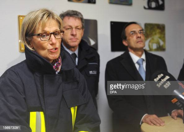 Local official Dorothea StoerrRitter Chief of Police Alfred Oschwald Leiter Polizeidirektion Freiburg and public prosecutor Alfred Haeberle address a...