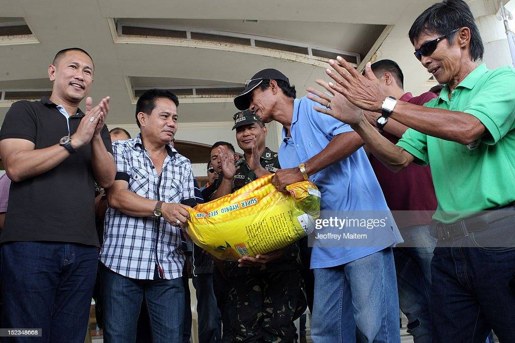 Local officials led by Ismael Mangudadatu, governor in the southern Philippine province of Maguindanao, distribute farm seedlings to residents during his first visit on September 19, 2012 in Datu Hoffer. The town is named after late Hoffer Ampatuan, one of the sons of Andal Ampatuan Sr. who was killed in shootout. Ampatuan Sr. is the alleged mastermind in the world's worst political mass murders on November 23, 2009 where Mangudadatu's wife, relatives and 30 journalists were massacred.