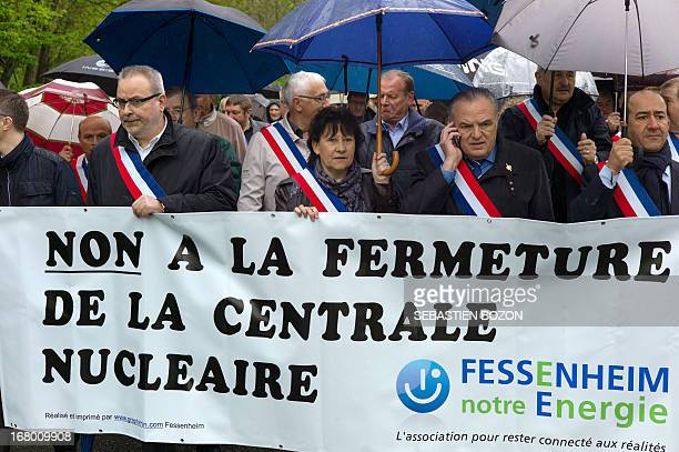 Local officials protest against the decision to close the nuclear powerplant of Fessenheim on May 4 2013 in Fessenheim eastern France Banner reads...