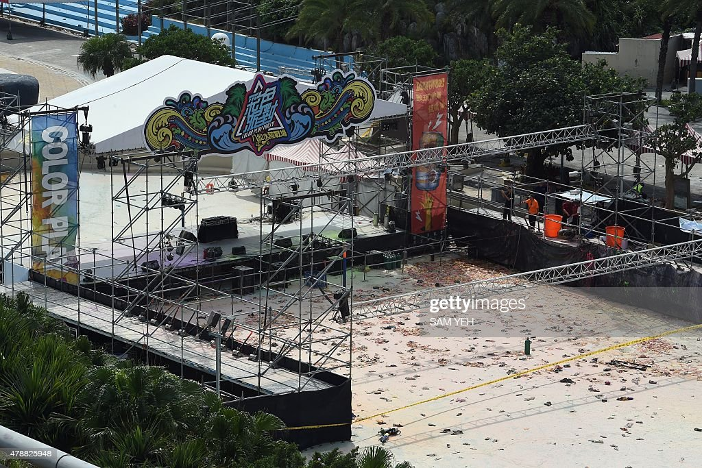 Local officials walk at the explosion site of the water park in Pali district in New Taipei City on June 28 2015 More than 500 people were injured...