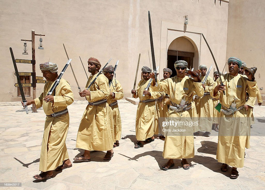 Local Omanis perform a traditional sword dance for Prince Charles Prince of Wales and Camilla Duchess of Cornwall during their visit to Nizwa Fort on...