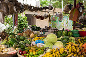 Open market kiosk with fruits and vegetables from in Granada, Nicaragua.  On kiosk are local products like bananas, melons, tomatoes, potatoes, cabbage, coffee, cocoa and many more tropical products.