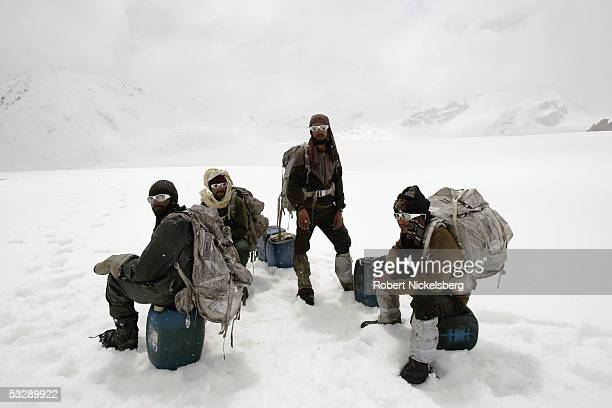 Local Pakistani porters rest before moving to forward military outposts on a resupply mission on a spur of the Siachen Glacier at 18655 feet June 19...