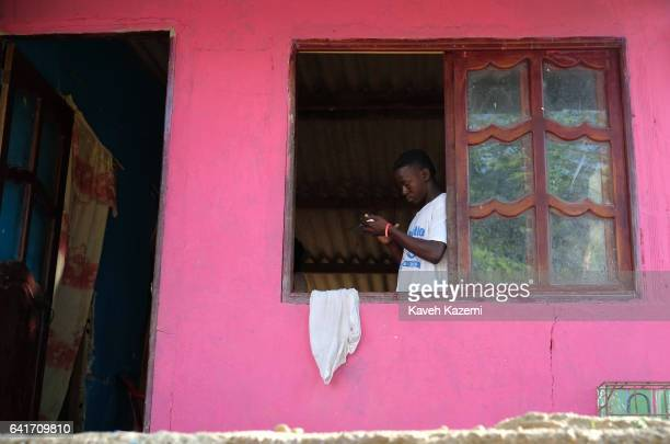 A local Palenquero man seen busy with his mobile phone behind the open window of his home on January 28 2017 in San Basilio de Palenque Colombia...