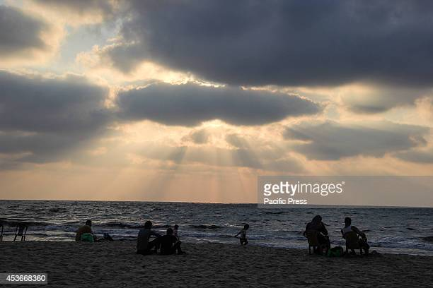 Local Palestinian children and their families during the sunset at the beach of Gaza City as Israel and Palestinians are observing a fiveday...