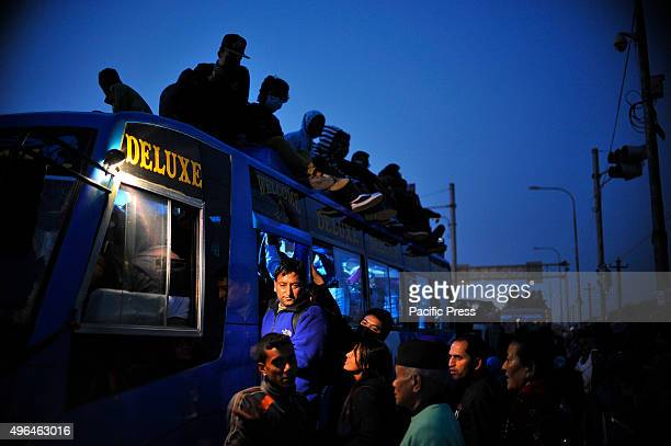 Local Passengers travel on the roof of overcrowded public buses as limited public transportation is running due to an ongoing fuel crisis in...