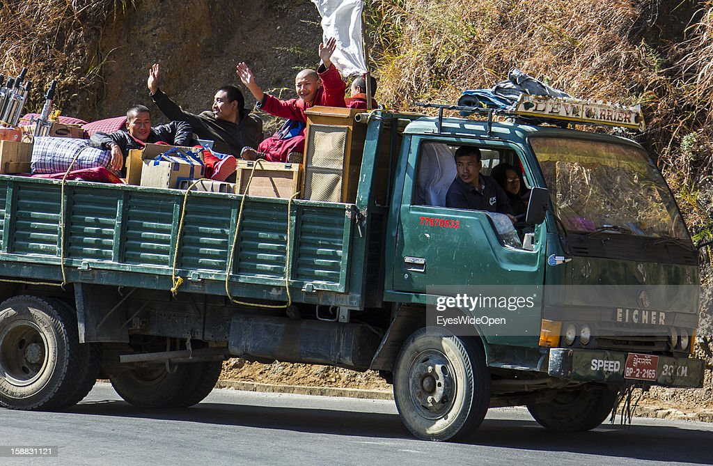 Local people and monks on a truck on November 18, 2012 in Chimi Lhakhang near Thimphu, Bhutan.