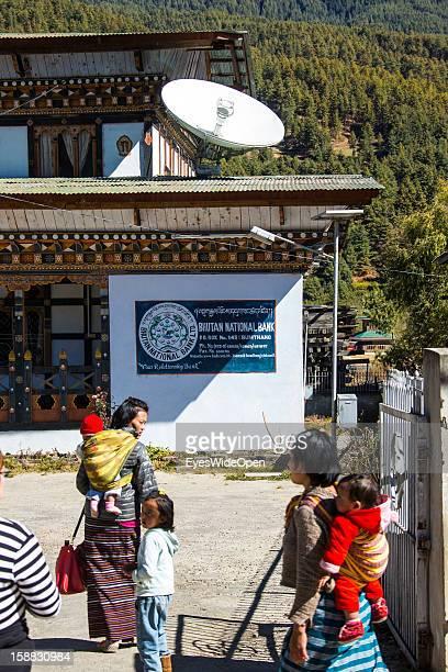 Local people at the Bhutan National Bank on November 18 2012 in Bumthang Bhutan