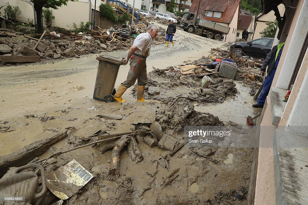 Local people begin clean-up efforts in the village center following a furious flash flood the night before on May 30, 2016 in Braunsbach, Germany. The flood tore through Braunsbach, crushing cars, ripping corners of houses and flooding homes during a storm that hit southwestern Germany. Miraculously no one in Braunsbach was killed, though three people died as a result of the storm in other parts of the country.