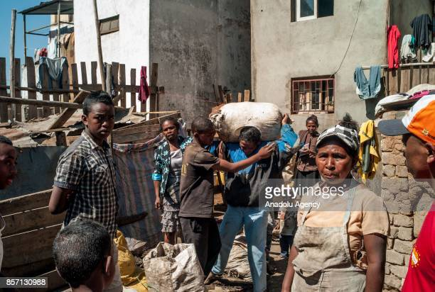 Local people clean their neighborhood in Antananarivo Madagascar as plague spreads rapidly in cities across the country on October 3 2017 Twenty...