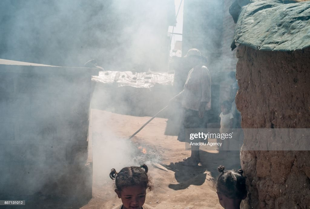 Local people clean their neighborhood in Antananarivo, Madagascar as plague spreads rapidly in cities across the country on October 3, 2017. Twenty people have died so far from plague in Madagascar while more than 100 other suspected cases have been registered across the country.