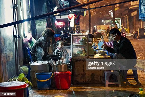 CONTENT] Local People eating street food in Hanoi Vietnam