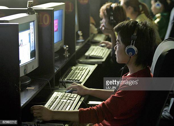 Local people enjoy the online games and chatrooms at an Internet cafe in Chengdu city in China's southwestern province of Sichuan 28 May 2005...