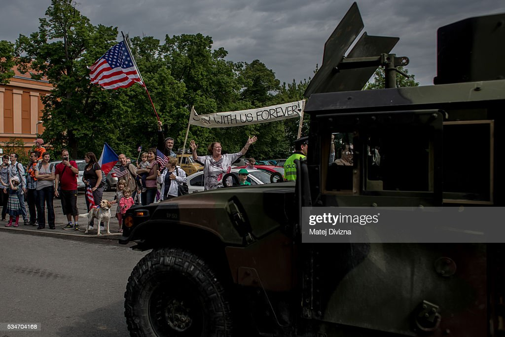 Local people greet U.S. soldiers of the 2nd Cavalry Regiment of the US Army as they arrive to Czech army barracks on May 27, 2016 in Prague, Czech Republic. About 420 U.S. soldiers with 225 army vehicles are travelling in the 'Dragoon Ride II' convoy from Germany to Estonia where they will participate in the Saber Strike 16 exercise in the Baltic region. With this exercise, NATO shows cohesiveness and readiness of the involved countries to collective defense and future operations in Europe.