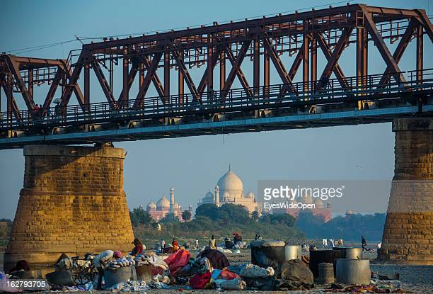 Local people make laundry near the famous indian sightseeing point Taj Mahal on December 01 2012 in Agra Uttar Pradesh India The UNESCO World...