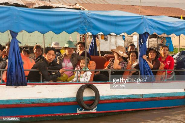Local people on a boat in the floating market Cai Rang near Can Tho Mekong River Delta Vietnam