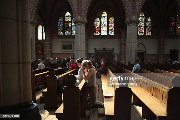 Local people pray during a special mass in Saint Vitus Church in memory of the victims of Malaysia Airlines flight MH17 on July 20 2014 in Hilversum...